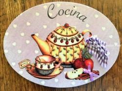 Placa de cocina con tetera, taza y fruta (con texto COCINA)