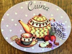 Placa de cocina con tetera, taza y fruta (con texto CUINA)