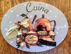 Placa de cocina con pasteles y café (con texto CUINA)