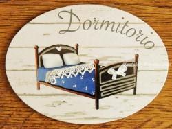 Placa de dormitorio con cama colcha azul (con texto DORMITORIO)